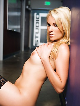Samantha Ryan strips down to pantyhose and stiletto heels and poses naked on the floor just outside Studio B at the Penthouse Studios.